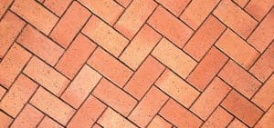 closeup photo of a brick patterned paving